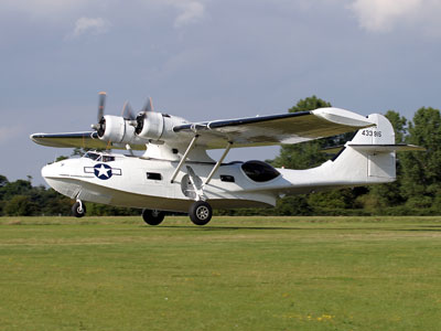 Our Catalina in the 8th Air Force Colours of 44-33915 landing at Rougham in the Summer of 2005. Photo: John Allan.